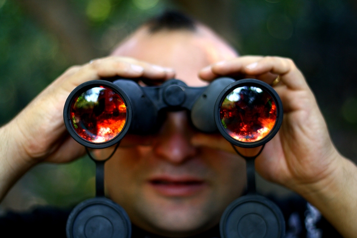 Man with coloured binoculars